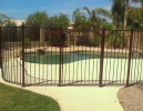 pool safety fencing with an arched gate